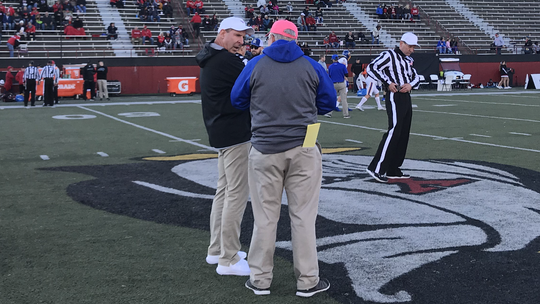 YSU coach Bo Pelini and SDSU coach John Stiegelmeier meet prior to Saturday's game in Youngstown. SDSU won 38-28.