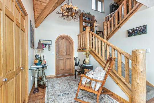 The Walkers' décor features rustic elements such as the entryway chandelier along with cherished family antiques, boho elements and splashes of color everywhere.