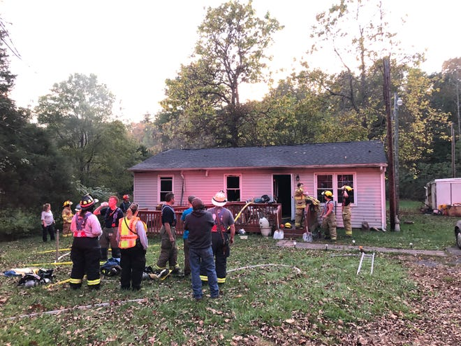 A house fire on the 1800 block of Little Calf Pasture Highway displaced four people on the evening of Oct. 13, 2019.