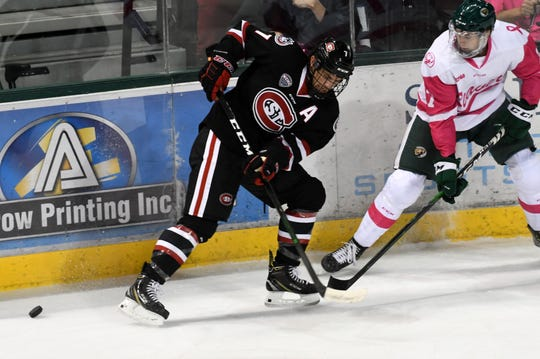 SCSU senior Nick Poehling battles along the boards with a Bemidji State defender in Saturday's contest.