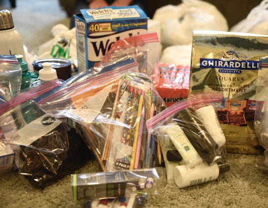 """Items donated for """"parent essential bags"""" include water bottles, snacks, hair ties and hygiene items, ear buds and more."""