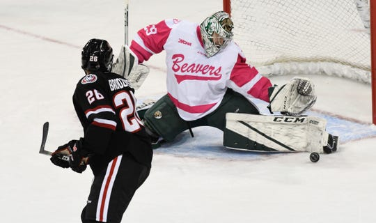 St. Cloud State's junior Easton Brodzinski puts a puck on net in the Huskies' nonconference game against Bemidji State.