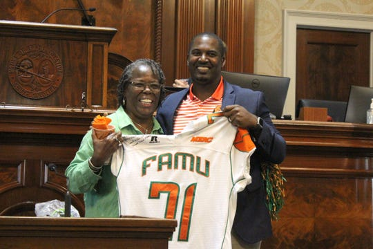 FAMU football head coach Willie Simmons shows off the jersey he presented to Rattler alum Gilda Cobb-Hunter at the South Carolina Statehouse in Columbia on Friday, Oct. 11, 2019. Cobb-Hunter is a state representative for District 66 in Orangeburg County.