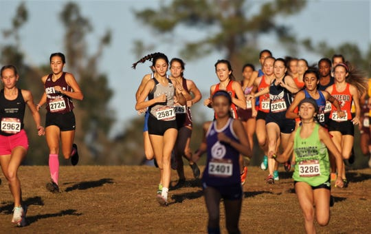 Maclay freshman Ella Porcher races during the FSU Invitational pre-state cross country meet at Apalachee Regional Park on Oct. 12, 2019.
