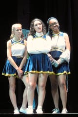 Liliana Virgen, center, plays Whitley, captain of the cheerleading squad