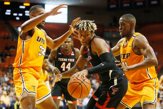 Texas Tech's Jahmi'us Ramsey goes against UTEP defense under the net during the game Saturday, Oct. 12, at the Don Haskins center in El Paso.