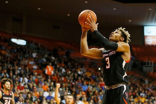 Texas Tech's Jahmi'us Ramsey shoots during a game against UTEP.