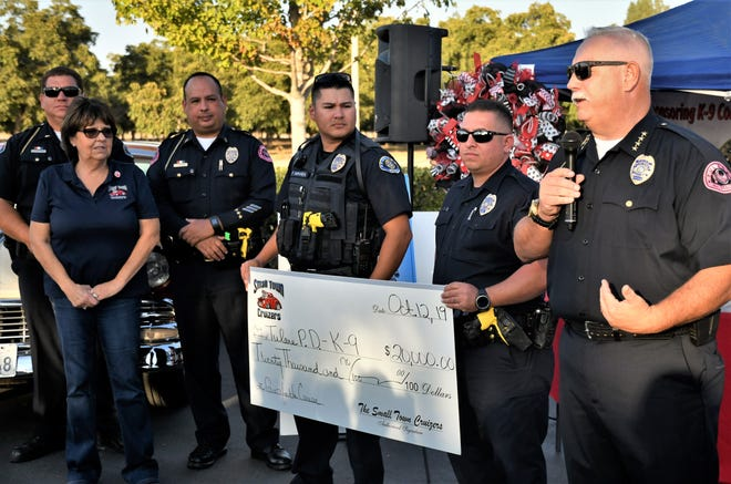 Small Town Cruizers car club presented Tulare Police Department with a $20,000 donation to the department's K9 Unit on Saturday, Oct. 12, 2019.