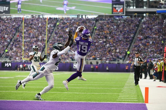 Adam Thielen (19) of the Minnesota Vikings attempts to pull in a pass, falling out of bounds in the first quarter while Malcolm Jenkins (27) of the Philadelphia Eagles applies pressure at U.S. Bank Stadium on Sunday, Oct. 13, 2019 in Minneapolis.
