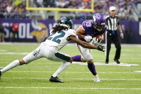 Minnesota Vikings wide receiver Adam Thielen (19) runs from Philadelphia Eagles cornerback Sidney Jones (22) after catching a pass during the first half of an NFL football game, Sunday, Oct. 13, 2019, in Minneapolis.