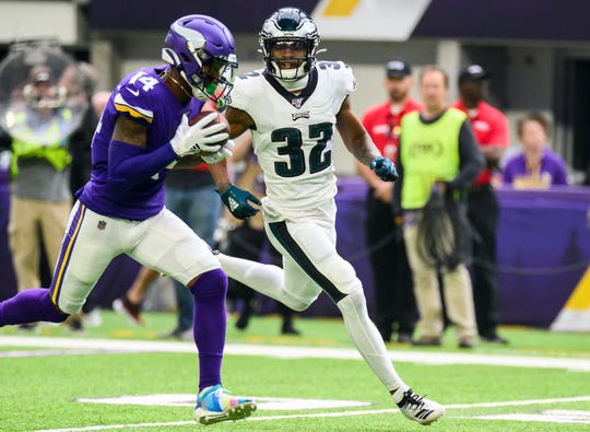 Stefon Diggs (14) of the Minnesota Vikings catches the ball for a 62 yard touchdown as Philadelphia Eagles' Rasul Douglas (32) trails in the second quarter at U.S. Bank Stadium on Sunday, Oct. 13, 2019 in Minneapolis.