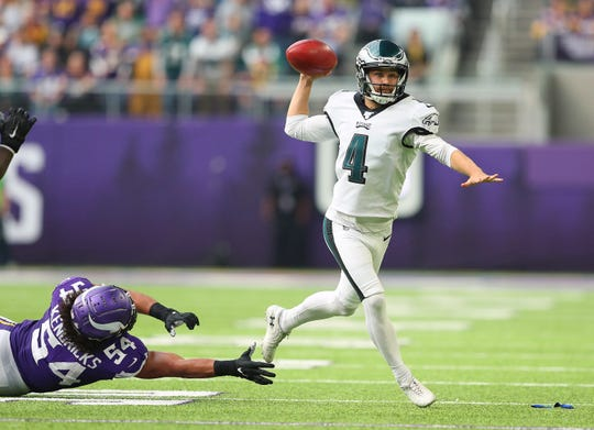 Jake Elliott (4) of the Philadelphia Eagles throws an interception while Eric Kendricks (54) of the Minnesota Vikings attempts the tackle in the second quarter at U.S. Bank Stadium on Sunday, Oct. 13, 2019 in Minneapolis.