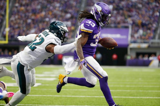 Minnesota Vikings running back Dalvin Cook scores on a 1-yard touchdown run ahead of Philadelphia Eagles inside linebacker Zach Brown, left, during the second half of an NFL football game, Sunday, Oct. 13, 2019, in Minneapolis.