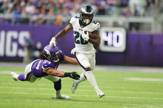 Miles Sanders (26) of the Philadelphia Eagles stiff arms Eric Kendricks (54) of the Minnesota Vikings in the second quarter at U.S. Bank Stadium on Sunday, Oct. 13, 2019 in Minneapolis.