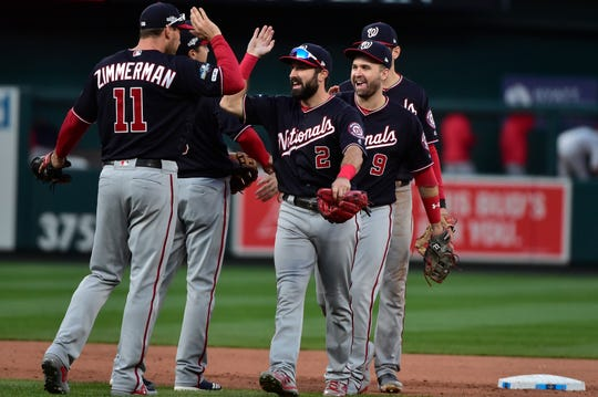 Nationals first baseman Ryan Zimmerman congratulates his teammates.