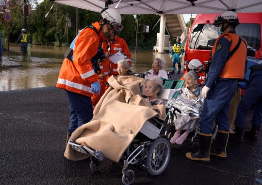 Elderly people are evacuated from a nursing home flooded by typhoon Hagibis and moved to another facility in Nagano, Nagano Prefecture, central Japan, 13 October 2019.