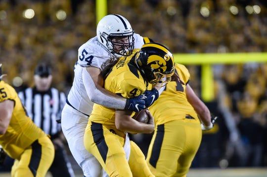 Penn State Nittany Lions defensive tackle Robert Windsor (54) sacks Iowa Hawkeyes quarterback Nate Stanley (4) during the third quarter at Kinnick Stadium.