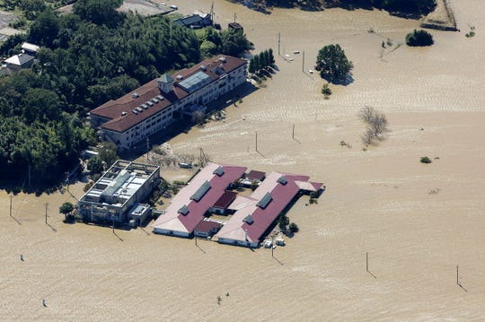 This aerial view shows the flooded Kawagoe Kings Garden nursing home besides the Oppegawa river in Kawagoe, Saitama prefecture on October 13, 2019, one day after Typhoon Hagibis swept through central and eastern Japan.
