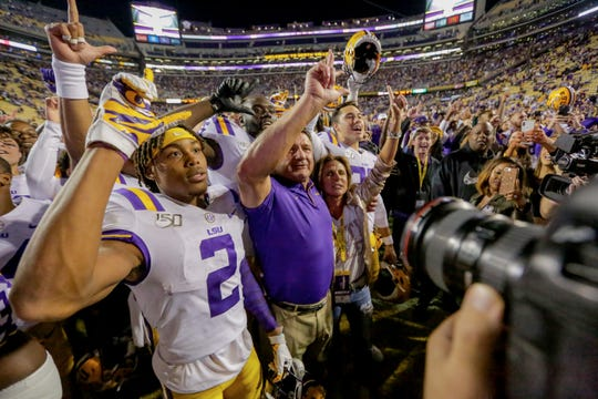 Oct 12, 2019; Baton Rouge, LA, USA; LSU Tigers head coach Ed Orgeron along with wide receiver Justin Jefferson (2) and teammates celebrate following a win against the Florida Gators at Tiger Stadium. Mandatory Credit: Derick E. Hingle-USA TODAY Sports