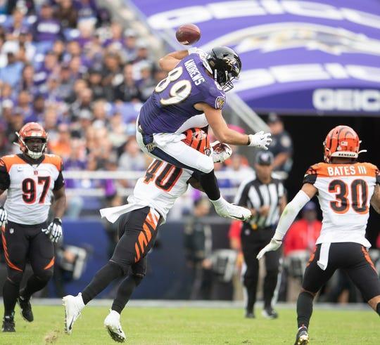 Baltimore Ravens tight end Mark Andrews (89) fumbles as Cincinnati Bengals defensive back Brandon Wilson (40).