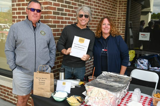 Jon Bon Jovi with Dave and Christine Ryan of the New Jersey State Police at the  5th annual JBJ Soul Kitchen Chili Cook-Off on Oct. 5 in Toms River.