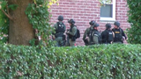 Police arrested a man barricaded inside an apartment building after he surrendered to authorities.