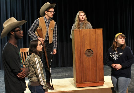 "The sheriff (Kalob Cotton) and speaker Susan B. Anthony (Natalie Porter) glance with others in attendance toward a disturbance at Anthony's talk in this rehearsal scene from ""This One Thing I Do,"" Abilene High School's fall drama that will be performed this weekend."