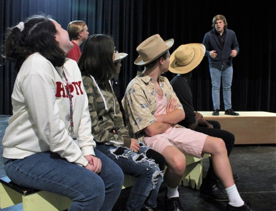 "The mayor (Jordan Mathis) cracks wise to townspeople about the roles of women during his introduction of Susan B. Anthony in this rehearsal scene from ""This One Thing I Do,"" Abilene High School's fall drama that will be performed this weekend."