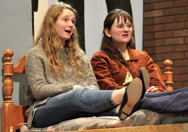 """Susan B. Anthony (Natalie Porter, left) talks with her bedridden friend Elizabeth Cady Stanton (Hannah Hillis) in this rehearsal scene from """"This One Thing I Do,"""" Abilene High School's fall drama that will be performed this weekend."""