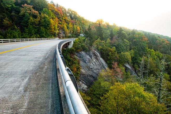 Oct. 11: The fall color change continues to progress in the higher-elevation areas of the Western North Carolina High Country, including sections of the Blue Ridge Parkway. Pictured here is the parkway bridge near Stack Rock (around BRP Milepost 304.8), colorfully accented by fall foliage.