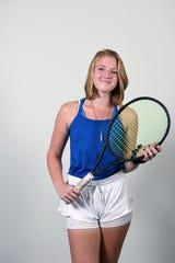 Kiki Stills plays tennis for West Henderson High School.