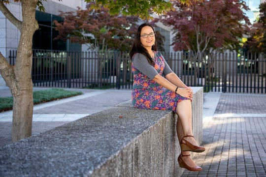 Ahira Sánchez-Lugo poses for a portrait outside of the Veach-Baley Federal Complex where she works as a climatologist with NOAA's National Centers for Environmental Information, on Oct. 11, 2019.