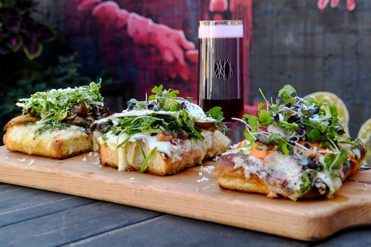 Three slices of the Funkatorium's Brett Pizza al Taglio paired with a Red Angel October 14, 2019. From left, smoked mushroom, carbonara and summer vegetable.