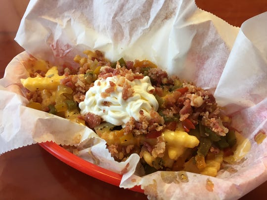 For something to go with your hot dog, Uncle Dogs offers unique sides like the Loaded Fries.