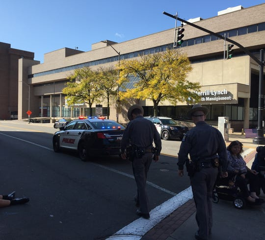 Police officers in downtown Binghamton took several protesters into custody after the Columbus Day high school marching band parade was interrupted by the demonstration.