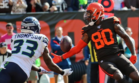 Seattle Seahawks free safety Tedric Thompson intercepts a pass for Browns wide receiver Jarvis Landry.