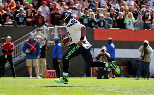 Russell Wilson rushes for a 16-yard touchdown during the first half against Cleveland.
