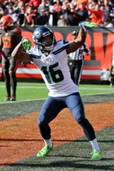 Seattle Seahawks wide receiver Tyler Lockett celebrates after a 16-yard touchdown during the second half against the Browns.