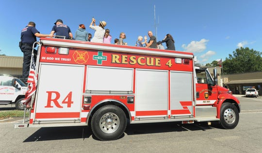 A group participating in the Black Mountain Fire Department's 100th anniversary celebration take in the view from atop the department's rescue engine.