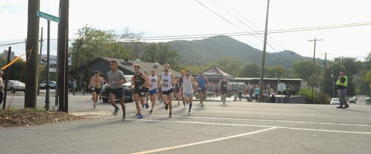 Runners cross State Street and head north on North Ridgeway Avenue to start the 2019 Lookout to Lookout to Lookout 10-mile Race, Oct. 12.