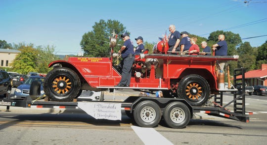 Retired Black Mountain firefighters, riding the department's 1926 American LaFrance fire truck, serve as Grand Marshals for the Oct. 12 parade celebrating BMFD's 100 years of service.