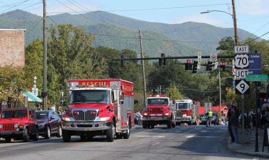 More than 60 trucks, and the Mountain Area Medical Airlift (MAMA) helicopter, pass through downtown Black Mountain on Oct. 12 to celebrate 100 years of service by the Black Mountain Fire Department. The procession was one of several events marking the occasion.