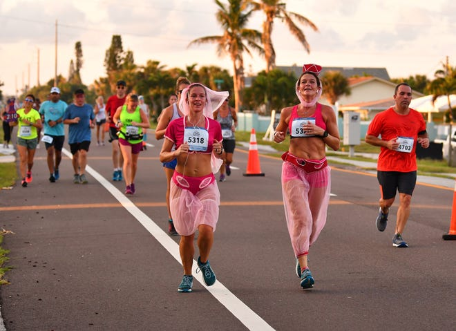"""Runners, many dressed in """"I Dream of Jeanne"""" costumes, make their way through Cocoa Beach for a previous  Cocoa Beach Half Marathon. The 2019 event, scheduled for Oct. 20, was approved for a $16,500 grant through the Space Coast Officer of Tourism's Sports & Event Grant Program."""