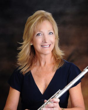 "Susan McQuinn, new conductor of the Space Coast Flute Orchestra, will lead the orchestra in ""Autumn Around the World"" at 3 p.m., Sunday, Oct. 27."