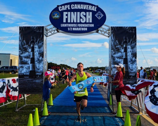 Steve Hedgespeth breaks the tape at the finish line to win the inaugural Cape Canaveral Lighthouse Foundation Half Marathon last year. The event will receive a $15,000 grant from the Space Coast Office of Tourism for this year's event, scheduled for Nov. 10.