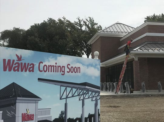 A worker helps build a Wawa on the 900 block of Haddonfield Road, Cherry HIll, in a September 2019 photograph.