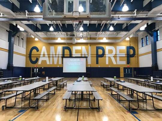 The cafeteria at Uncommon Camden Prep has new air conditioning, floors and video screens.