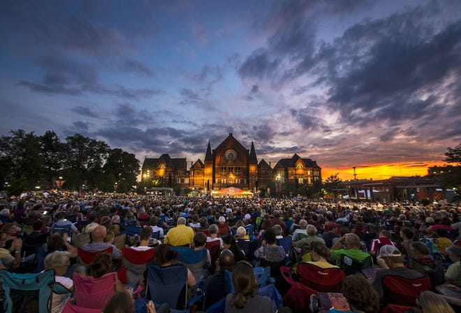 The sun sets over Music Hall during the 2015 Lumenocity concert at Washington Park in the Over-the-Rhine.