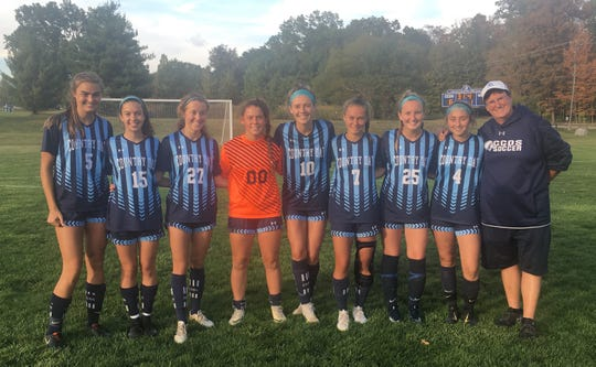 The Cincinnati Country Day girls soccer team celebrating Senior Night were, from left: Lawson Renie, Katie Ashwell, Natalie de Beer, Lilly Reisenfeld, Kate Brock, Joely Virzi, Alexandra Vredeveld, Sabrina Buechly and coach Theresa Hirschauer