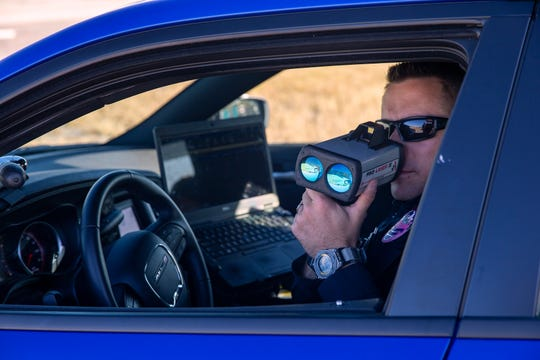 Corporal Josh Nezi with the Erlanger Police Department monitors traffic as part of traffic enforcement blitz on October 14, 2019, along Interstate 71/75 in Northern Kentucky.  Police officers were out in force Monday, part of a federally funded campaign against aggressive and dangerous driving on that stretch of highway, from the Ohio River to Interstate 275 in Erlanger.